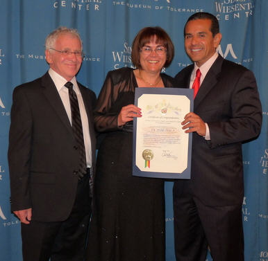 "Gyöngyi Mangó receiving the Medal of Valor, May 5, 2011 in Hollywood. On her left is Gabor Kalman, the director of ""There Was Once..."""