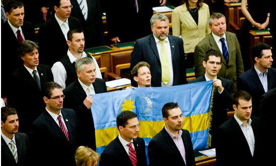 "Members of Jobbik parliamentary members holding up the ""székely flag"