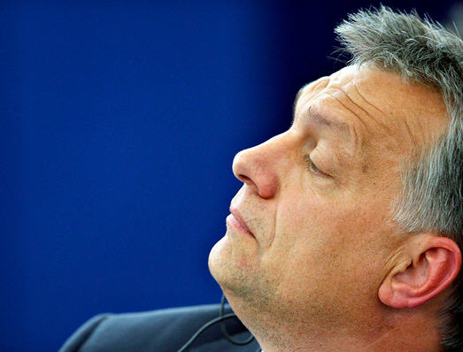 Viktor Orbán listening to the speeches / Reuters, Vincent Kessler