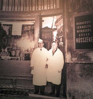 Mr. and Mrs. Kövesi in front of their butcher shop