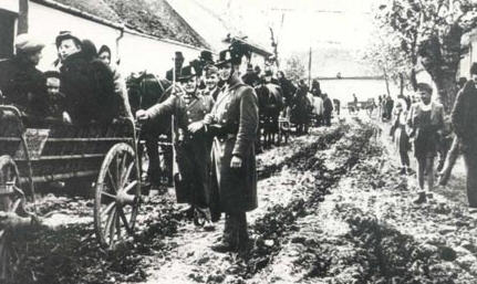 Hungarian gendarmes supervise the transportation of provincial Jews to the designated railroad stations