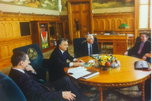 Viktor Orbán's study with the controversial poster in the background