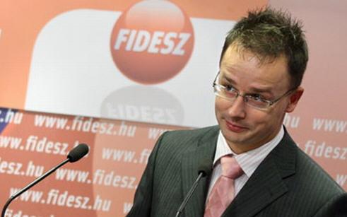 Péter Szijjártó as Viktor Orbán's spokesman