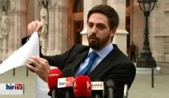 "Undersecretary Levente Magyar waving ""the scrap of paper"" from the U.S. Embassy"